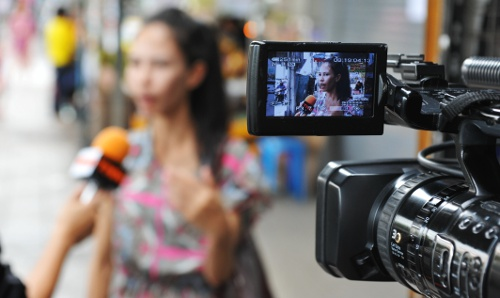woman being filmed on video camera